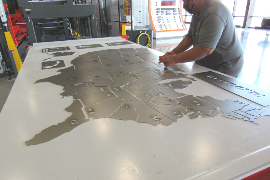 A map of the USA with each state cut by our laser cutting machines and sorted by BySort automation, was demonstrated.