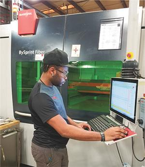 An ERP system ties into Decimal's production equipment, including the new laser-cutting cell, to allow paperless workflow control.