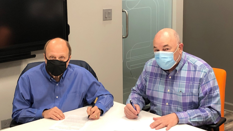 President of Bystronic Inc. and President of CLOOS signing agreement
